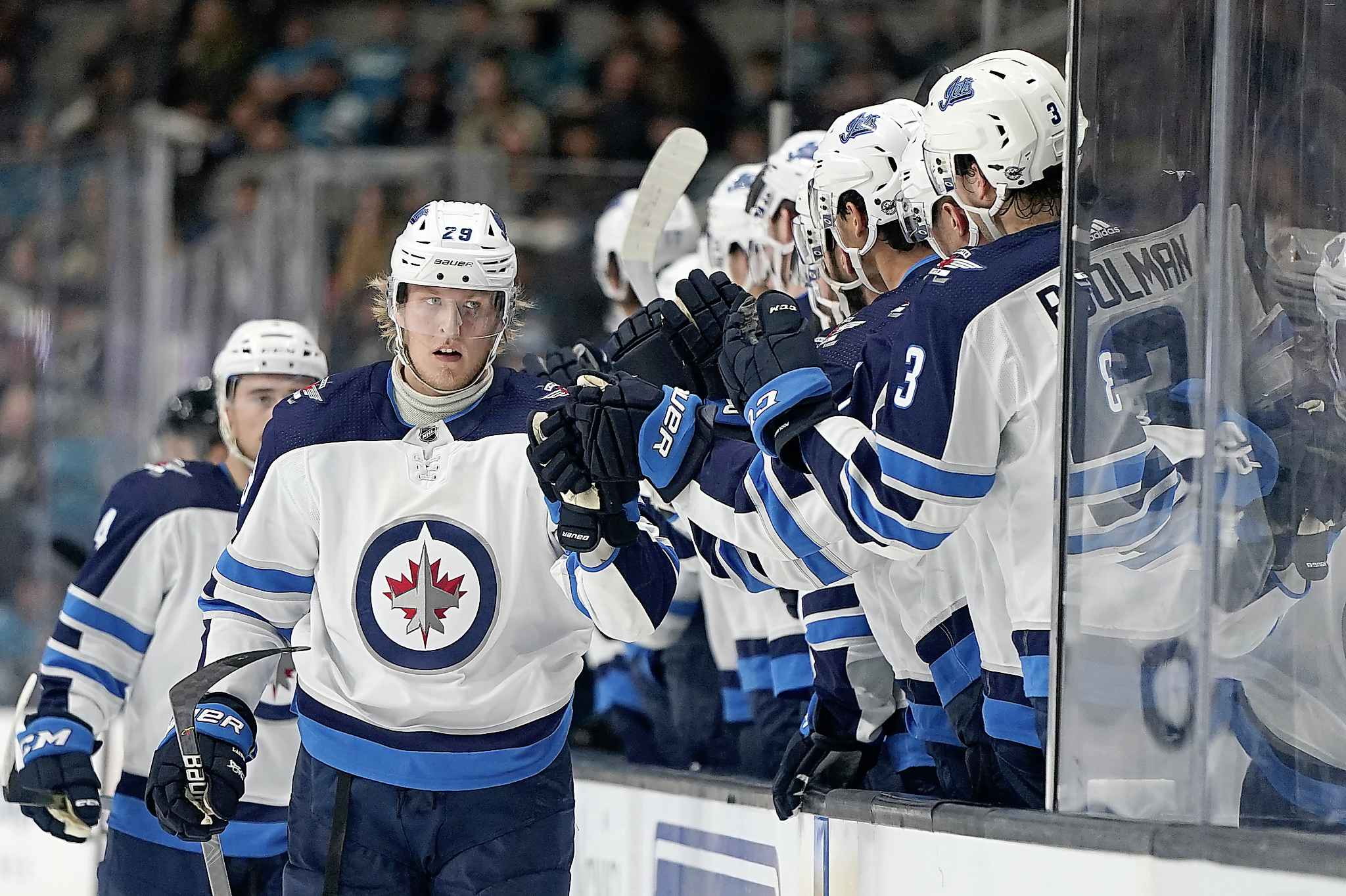 Winnipeg Jets right wing Patrik Laine is congratulated by teammates after scoring a power play goal against the Sharks during the first period Wednesday.