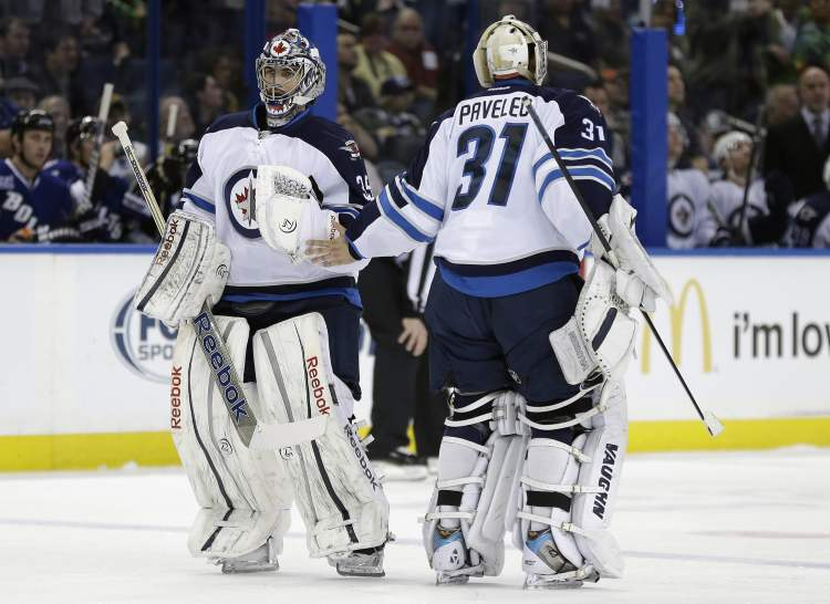 Winnipeg Jets goalie Al Montoya replaces Ondrej Pavelec during the second period against the Tampa Bay Lightning Friday. Pavelec gave up five goals before he was pulled in the 8-3 loss.