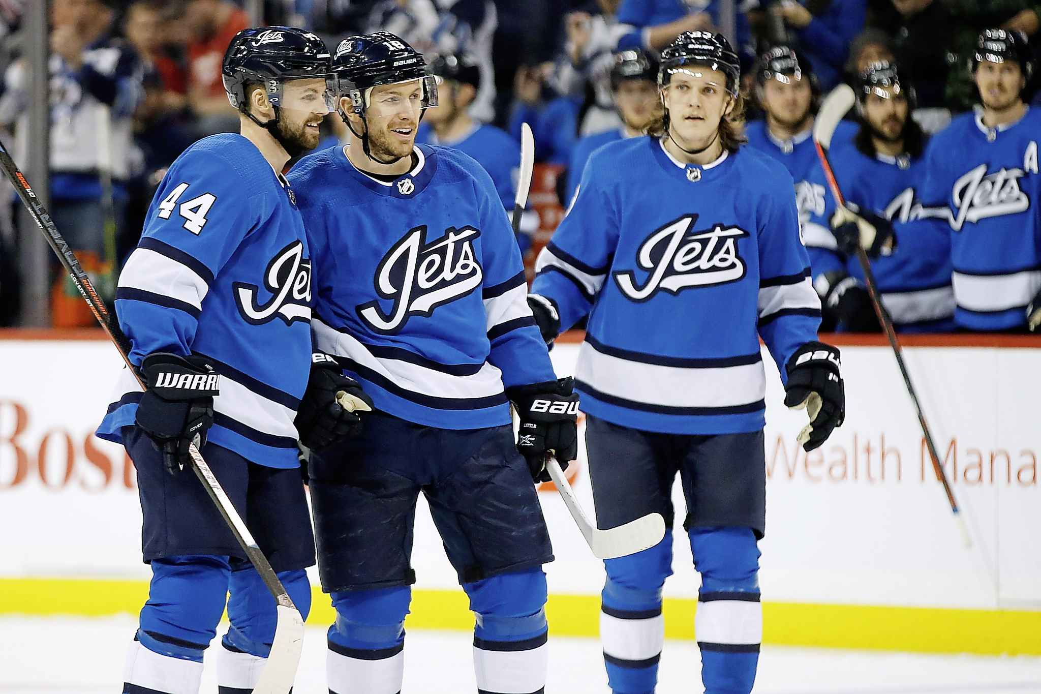 Winnipeg Jets' Josh Morrissey, Bryan Little and Sami Niku celebrate Little's goal against the Detroit Red Wings Friday. The point was Little's 500th in his NHL career, all of which came playing for the Atlanta Thrashers/Winnipeg Jets franchise.