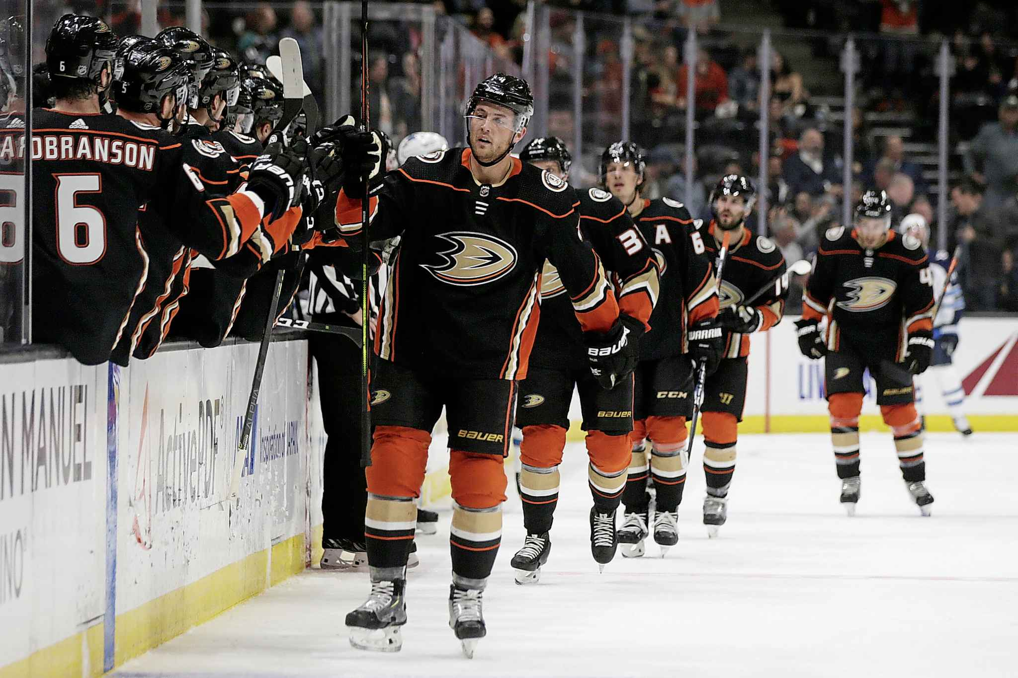 Anaheim Ducks defenceman Cam Fowler, centre, gets congratulations from teammates after scoring on the Winnipeg Jets during the first period in Anaheim, Tuesday.