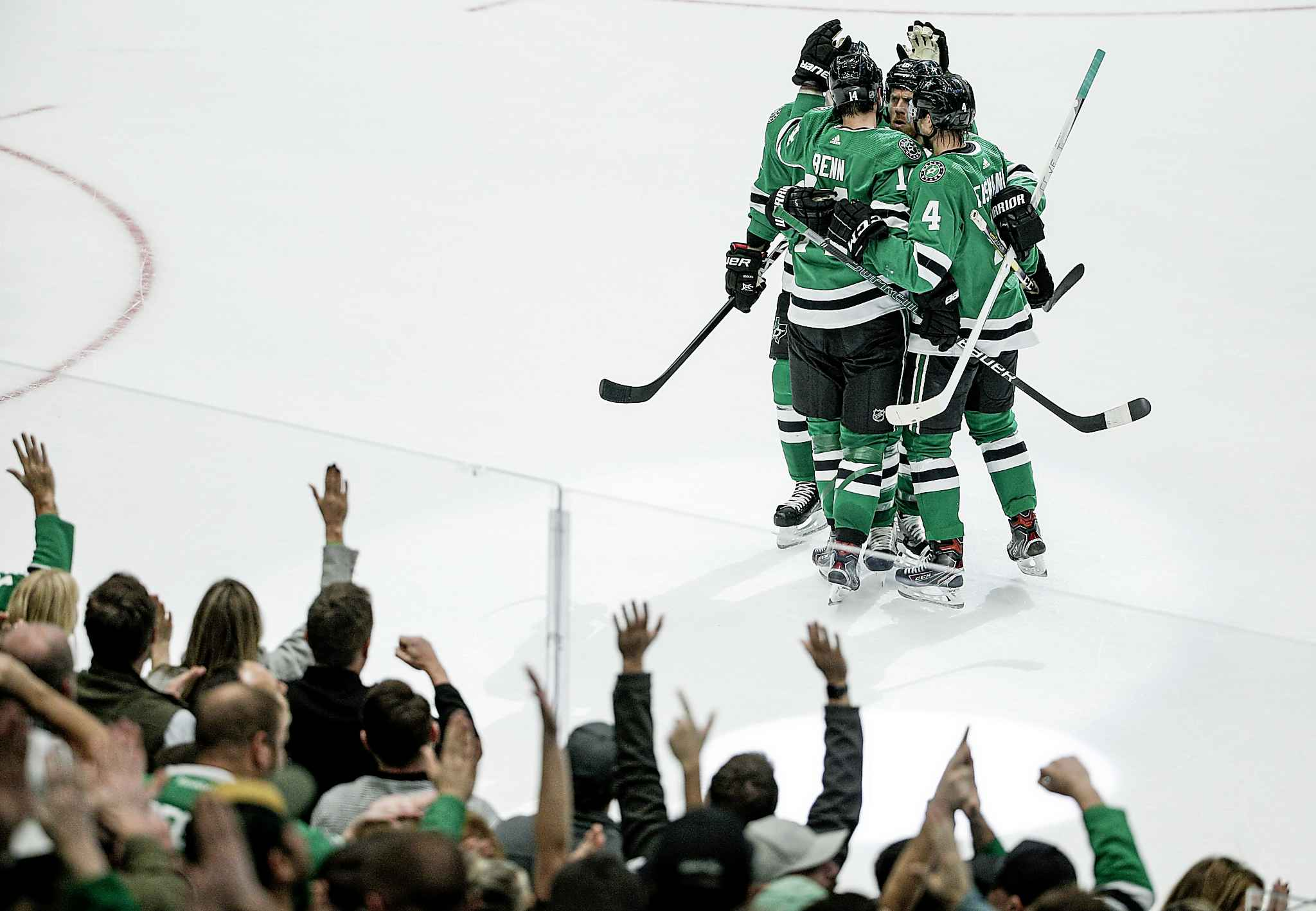 Dallas Stars forward Jamie Benn is congratulated by teammates after scoring a goal during the first period against the Winnipeg Jets on Thursday in Dallas.