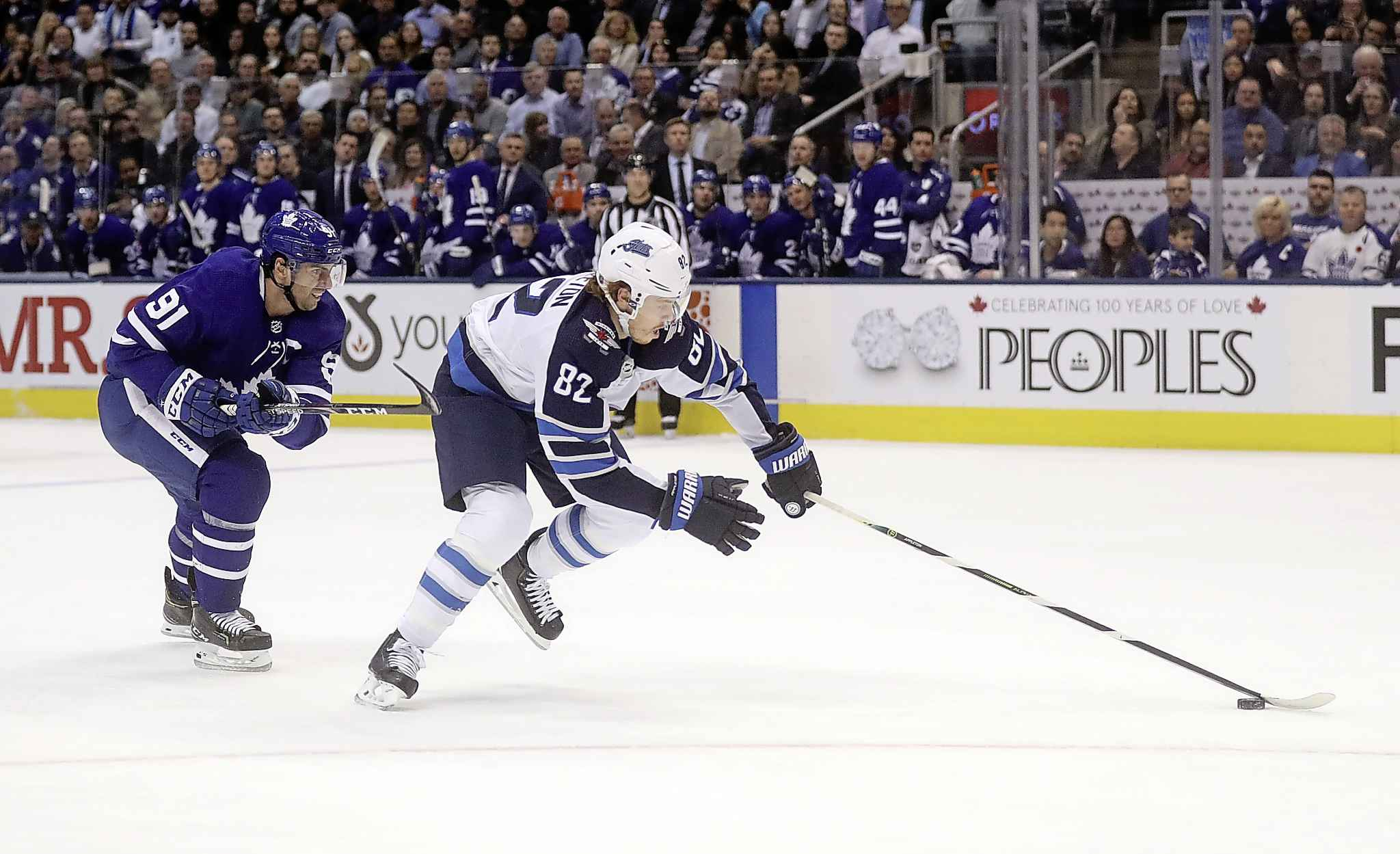 Toronto Maple Leafs' John Tavares trails Winnipeg Jets' Mason Appleton as he streaks in on a breakaway short-handed goal during the first period in Toronto Wednesday.