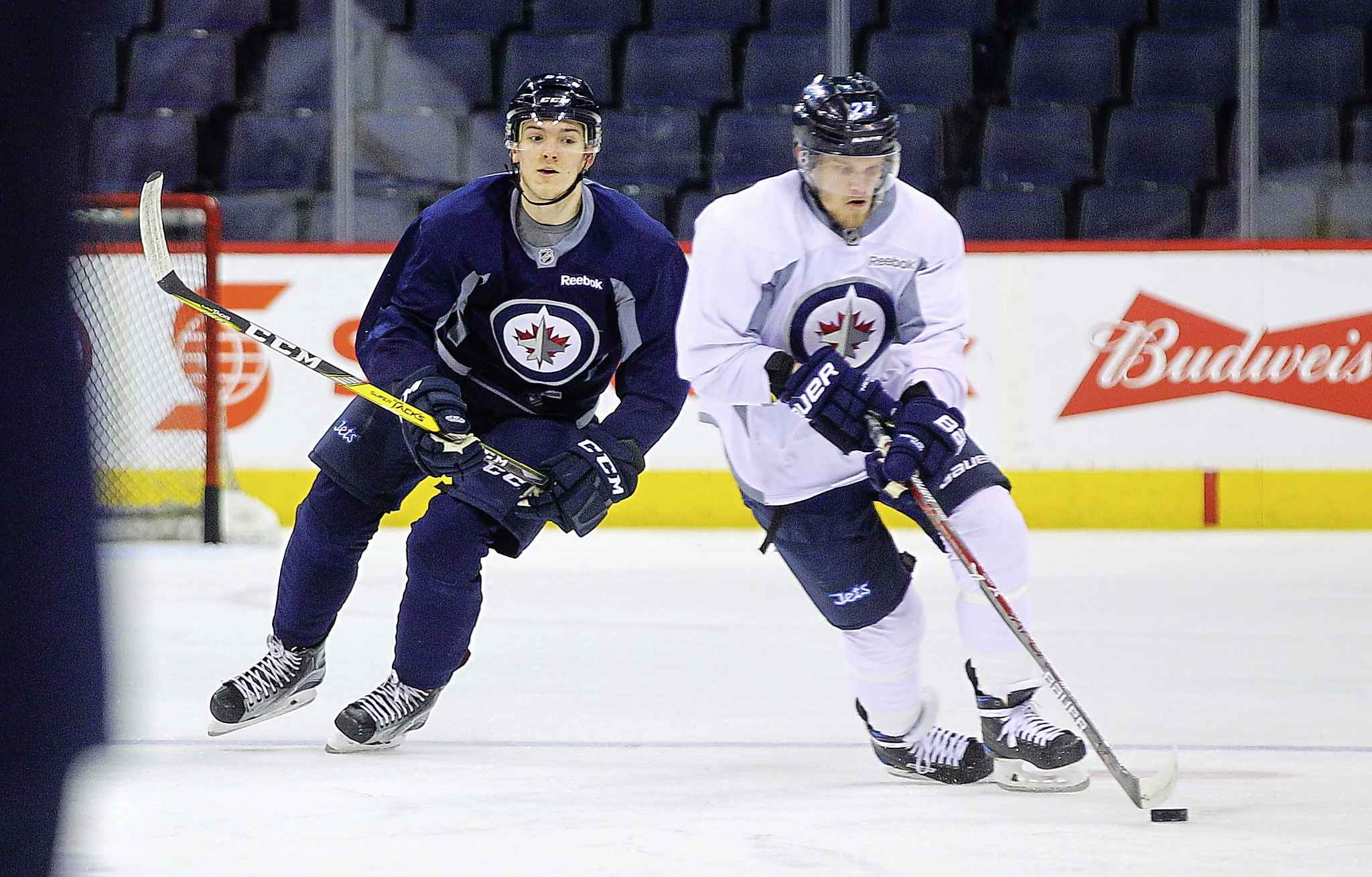 Winnipeg Jets' Jack Roslovic, left, and Nikolaj Ehlers make up two-thirds of the team's new-look fourth line.