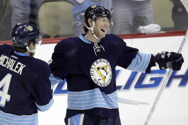 Pittsburgh Penguins' James Neal, right, celebrates his goal with teammate Zbynek Michalek in Pittsburgh on Saturday.