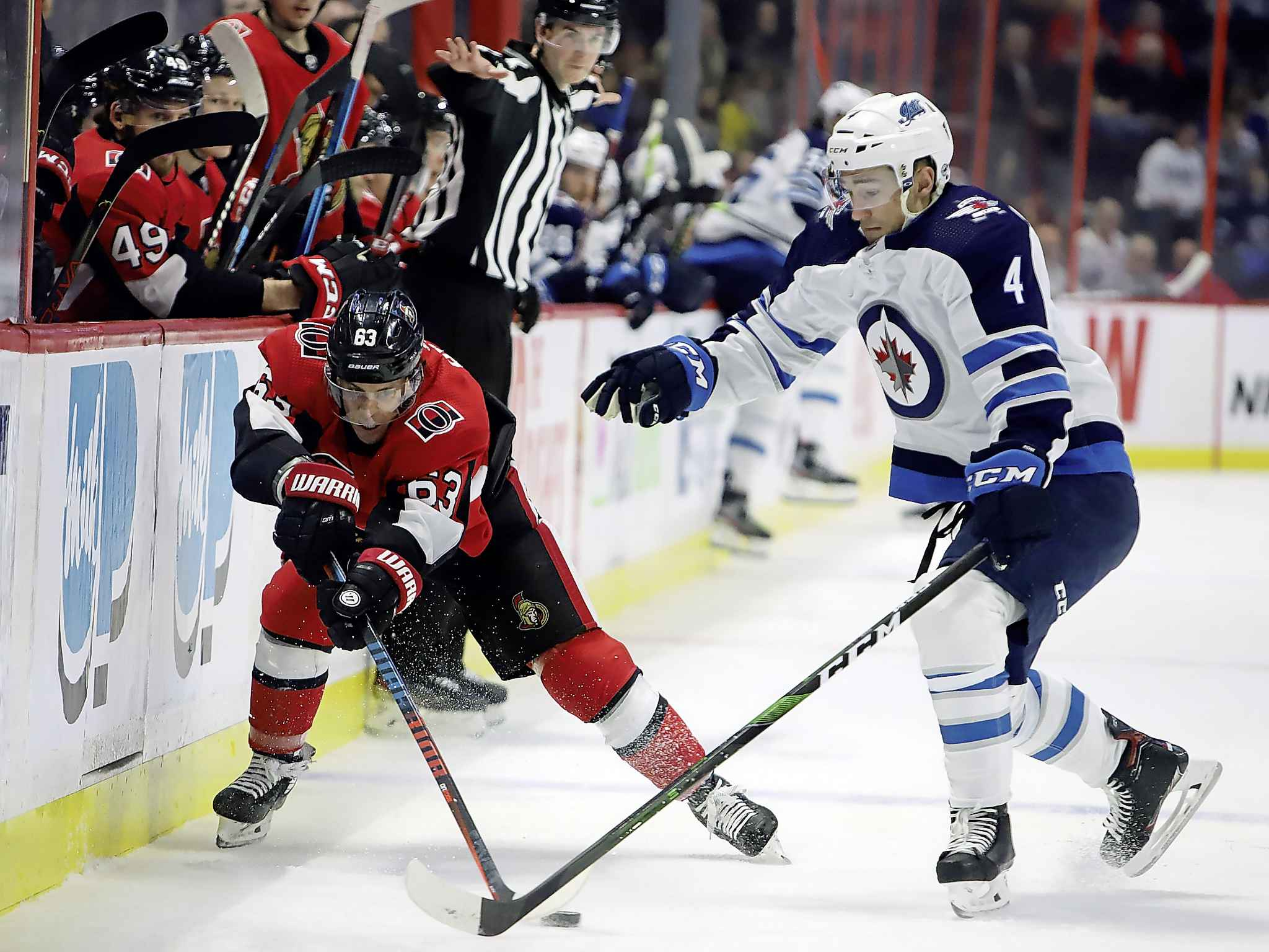 Ottawa Senators right wing Tyler Ennis and Winnipeg Jets defenceman Neal Pionk battle for the puck during the second period.