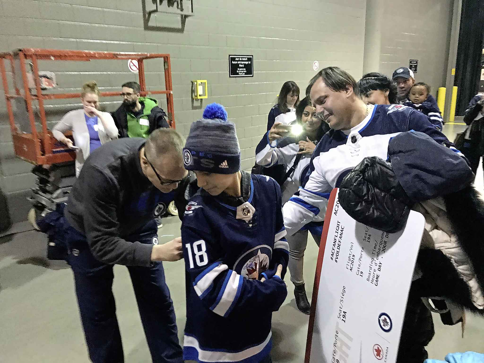 Arsenii Varchuk and his dad, Yuriya, met Jets head coach Paul Maurice as part of an Air Canada fan promotion.