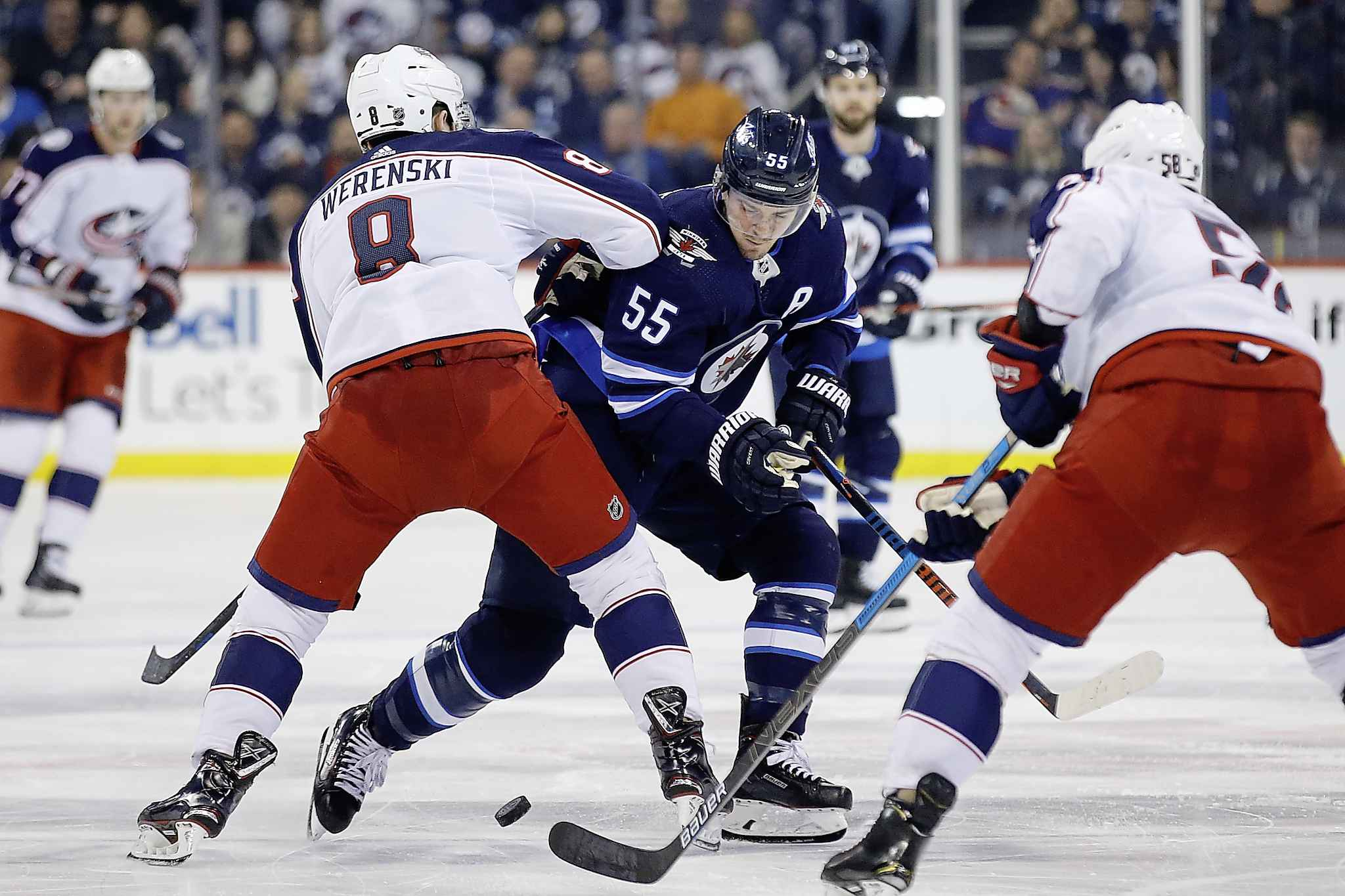 Zach Werenski, from Columbus Blue Jackets, gets a two minute interference penalty against Mark Scheifele from Winnipeg Jets during the second season of the NHL action Thursday.