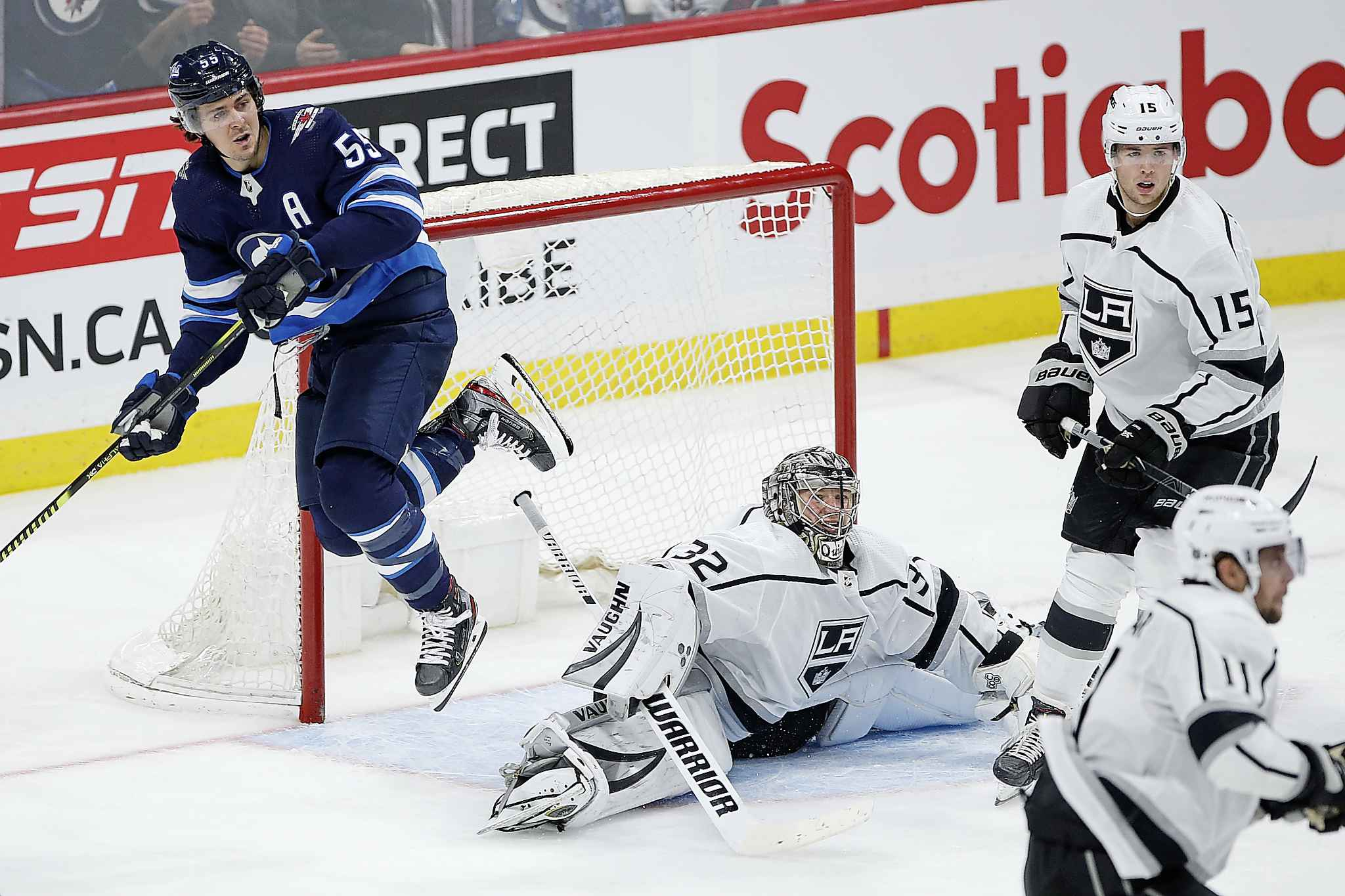 Winnipeg Jets' Mark Scheifele leaps over Los Angeles Kings goaltender Jonathan Quick during the second period.