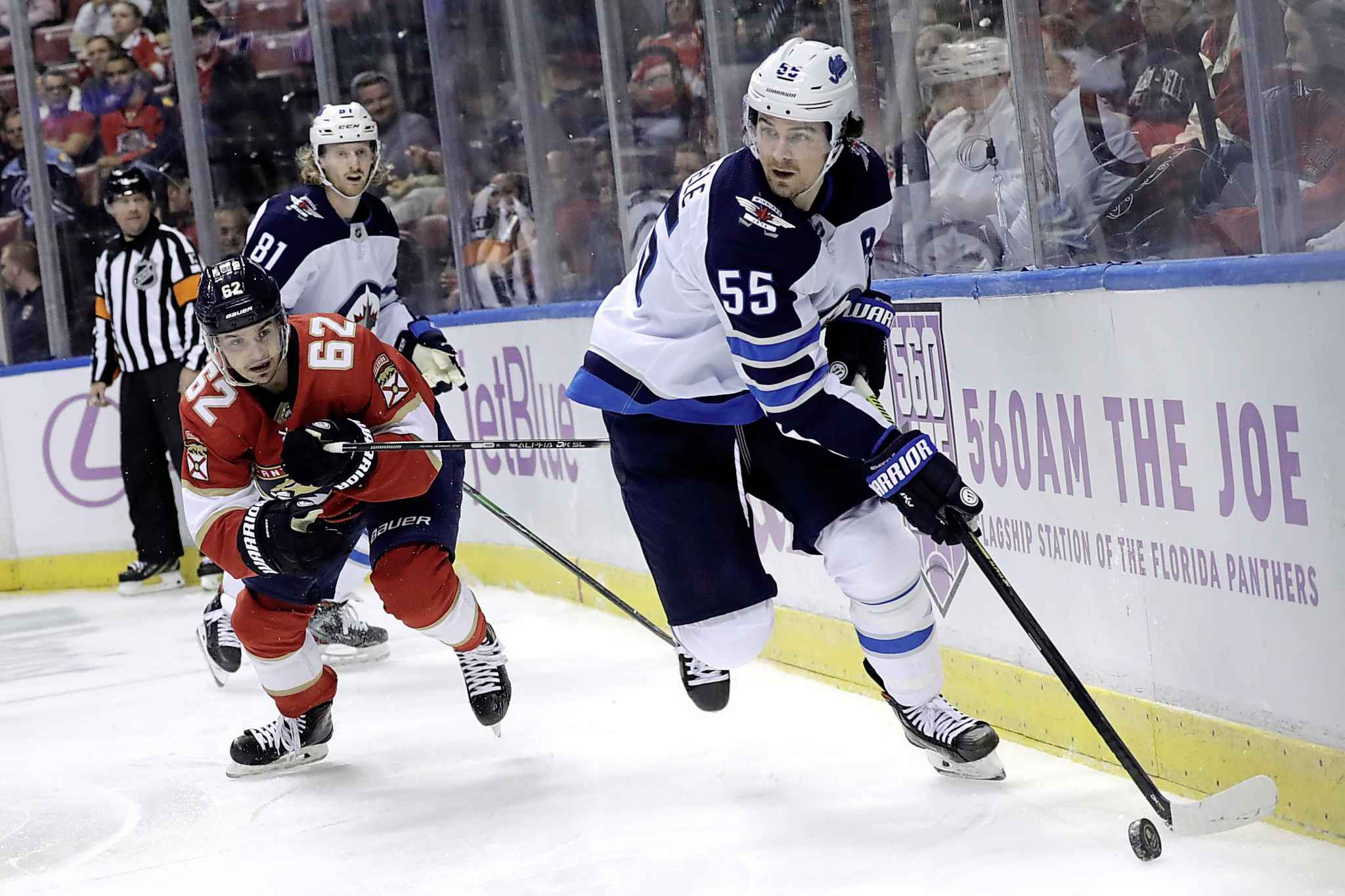 Winnipeg Jets centre Mark Scheifele rags the puck as Florida Panthers' Denis Malgin defends during the second period.