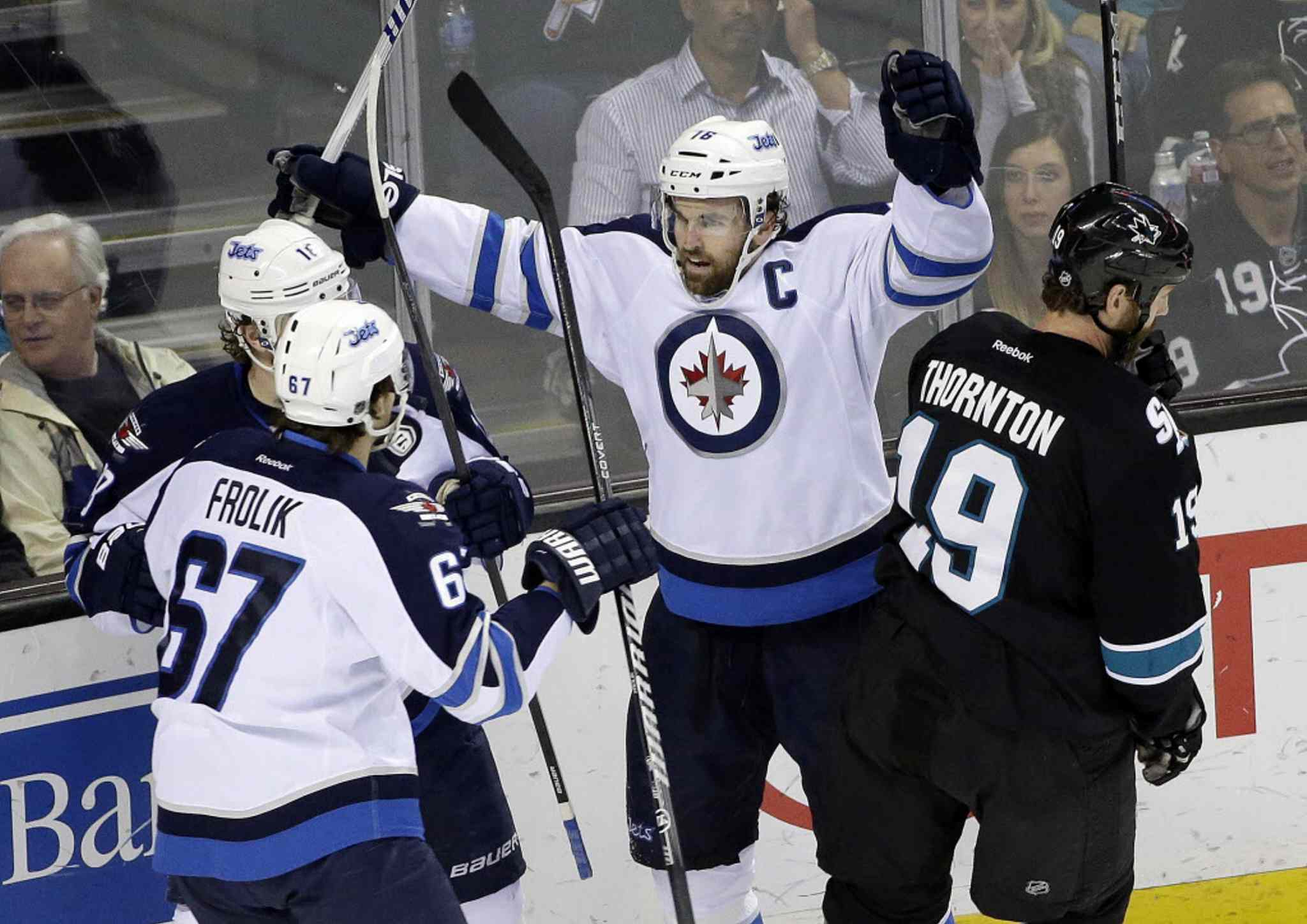 Winnipeg Jets' Andrew Ladd, center, celebrates his goal against the San Jose Sharks during the first period Thursday night in San Jose, Calif.