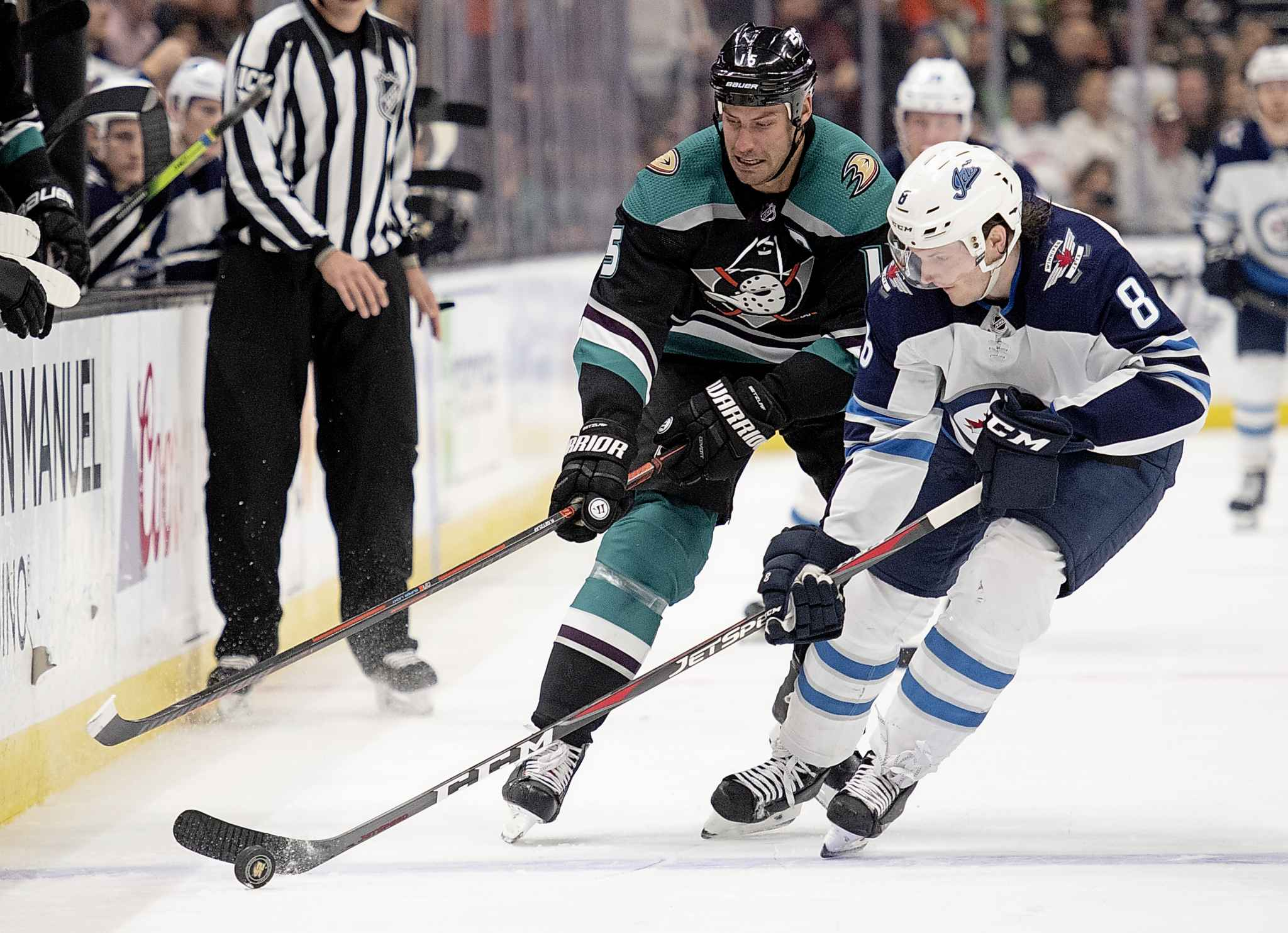 Anaheim Ducks centre Ryan Getzlaf, back, chases Winnipeg Jets defenceman Jacob Trouba for the puck during the second period.