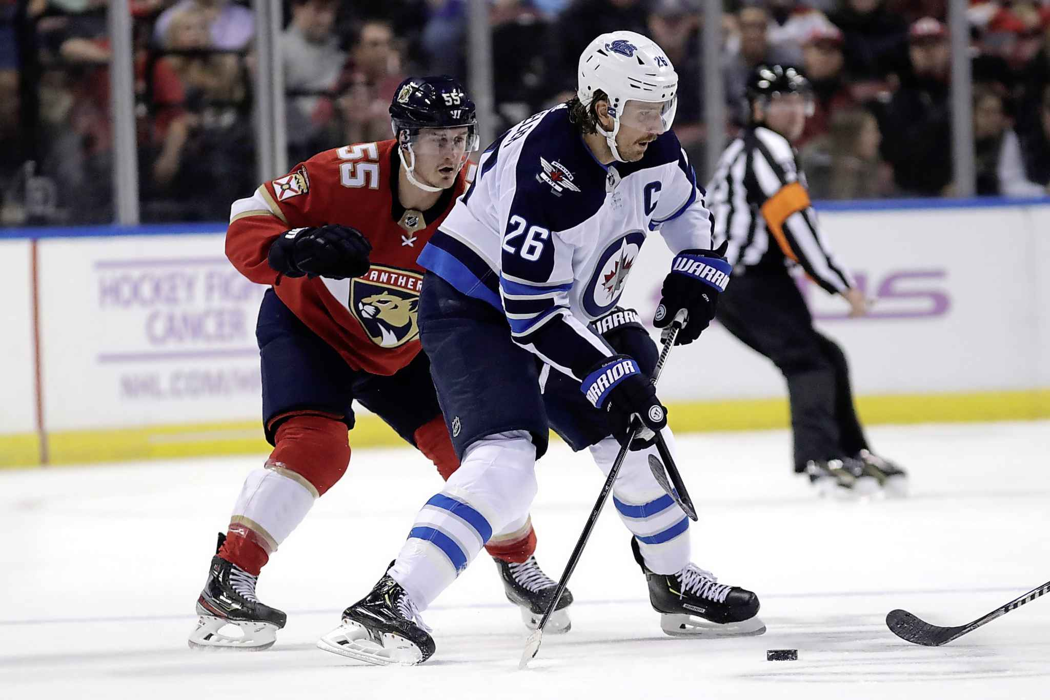 Winnipeg Jets' Blake Wheeler looks to pass as Florida Panthers' Noel Acciari defends during the first period.