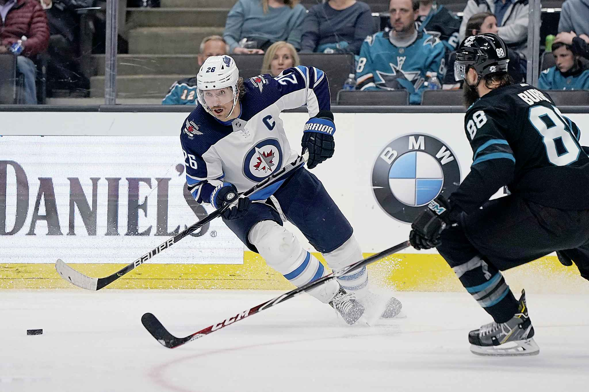 Winnipeg Jets' Blake Wheeler cuts to the middle against San Jose Sharks defenceman Brent Burns during the second period in San Jose, Friday.