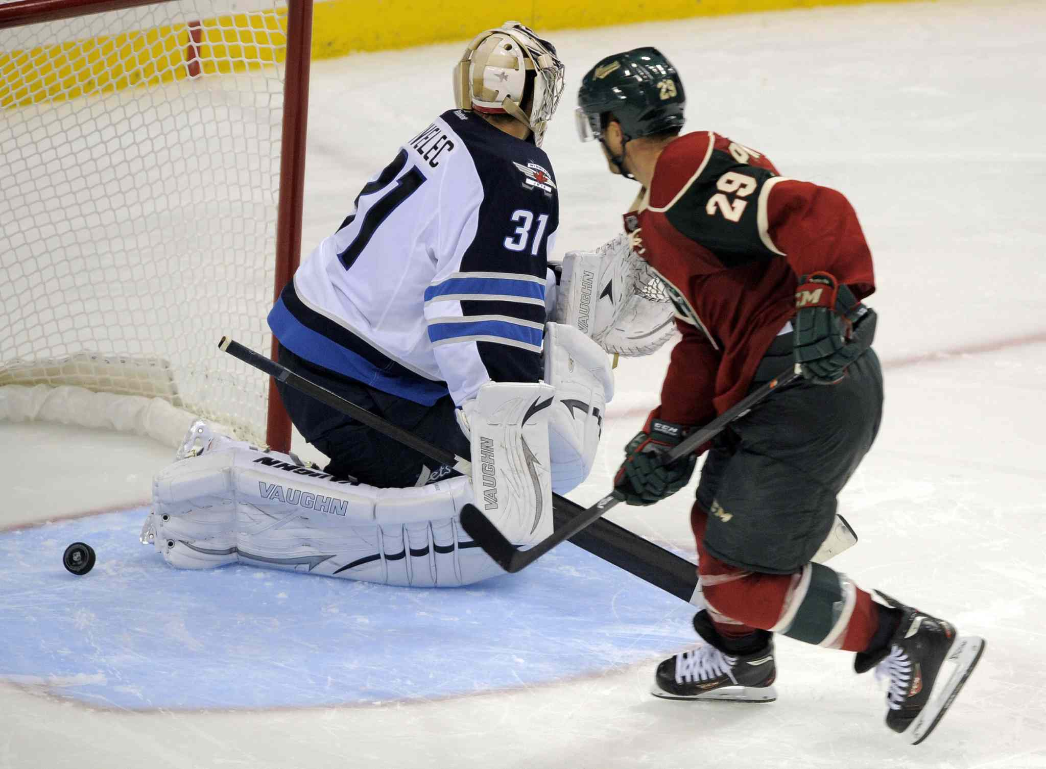 Minnesota Wild's Jason Pominville (29) beats Winnipeg Jets goalie Ondrej Pavelec for the winning goal in the shootout. Minnesota won 4-3.