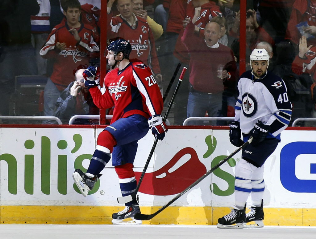 Washington Capitals' right wing Troy Brouwer (20) celebrates his first-period goal in front of Winnipeg Jets' right wing Devin Setoguchi (40) during Thursday's game in Washington.