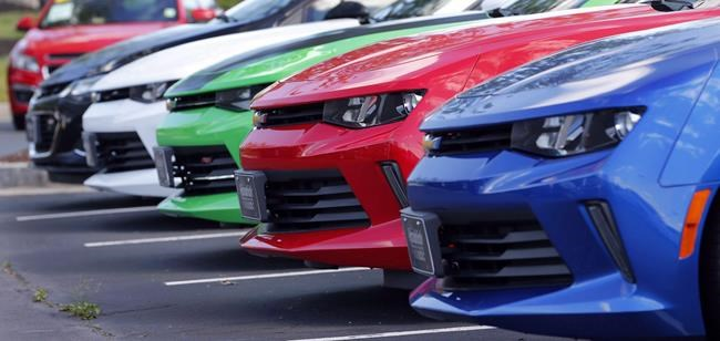 Cars are lined up in the lot of a Chevrolet dealership in Richmond, Va., on Wednesday, April 26, 2017. DesRosiers Automotive Consultants says Canadian auto sales dropped by 44 per cent in May, an improvement from the estimated 74.6-per-cent decline in April when the COVID-19 outbreak first affected a full month of sales. THE CANADIAN PRESS/AP-Steve Helber
