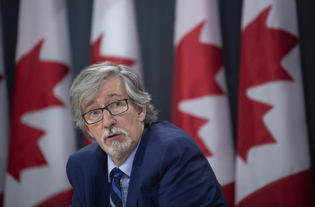 Privacy Commissioner Daniel Therrien speaks during a news conference in Ottawa, Tuesday, December 10, 2019. Canada's privacy commissioner has released a framework for governments on smartphone apps used to help trace a person's contacts if they're diagnosed with COVID-19. Daniel Therrien says the collected data should be destroyed when the pandemic ends. THE CANADIAN PRESS/Adrian Wyld