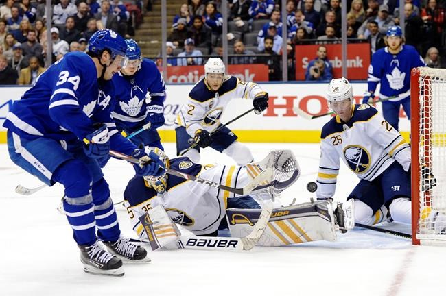 Toronto Maple Leafs centre Auston Matthews (34) scores on Buffalo Sabres goaltender Linus Ullmark (35) as Sabres defenceman Rasmus Dahlin (26) defends during second period NHL hockey action in Toronto on Tuesday, December 17, 2019. THE CANADIAN PRESS/Nathan Denette