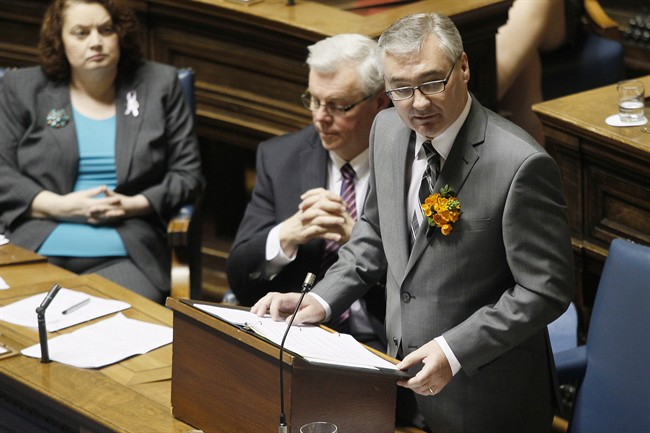 Manitoba Premier Greg Selinger (left) and other ministers listen as Finance Minister Stan Struthers tables the 2012-2013 budget at the Manitoba Legislature in Winnipeg on Tuesday.