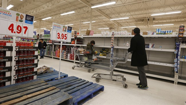 With a run on bottled water earlier in the day late night shoppers were were greeted with empty shelves and pallets after Winnipeg authorities issued a boil water advisory after a e.coli positive test Tuesday, January 27, 2015. THE CANADIAN PRESS/John Woods