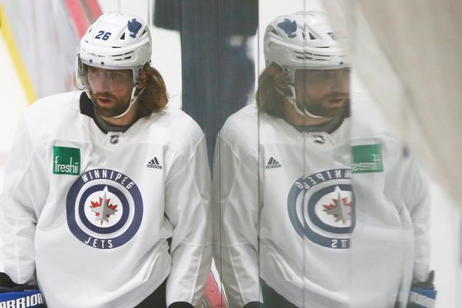 Winnipeg Jets' Blake Wheeler (26) looks on during the first day of the Jets NHL summer training camp as the NHL reopens during COVID-19 in Winnipeg, Monday, July 13, 2020. THE CANADIAN PRESS/John Woods