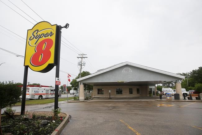 Emergency personnel were called to a gas leak at a Super 8 hotel in Winnipeg Tuesday, July 9, 2019. Forty six people were taken to emergency hospitals. THE CANADIAN PRESS/John Woods