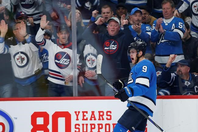 Winnipeg Jets' Andrew Copp (9) celebrates his goal against the St. Louis Blues during second period NHL action in Winnipeg on Saturday, February 1, 2020. THE CANADIAN PRESS/John Woods