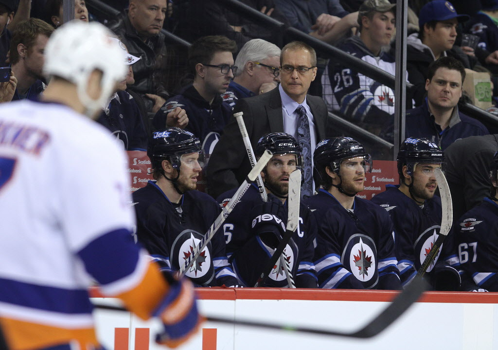 Winnipeg Jets head coach Paul Maurice watches during a break during third-period NHL action against the New York Islanders at the MTS Centre in Winnipeg on Tues., March 4, 2014.