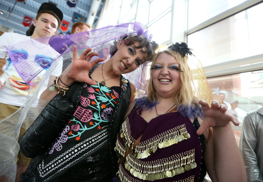 Sisters Courtney (left) and Hillary Duggan (both are Winnipeggers) pull a very Gaga-esque pose while waiting for the doors to open at the MTS Centre.  (Jason Halstead / Winnipeg Free Press)