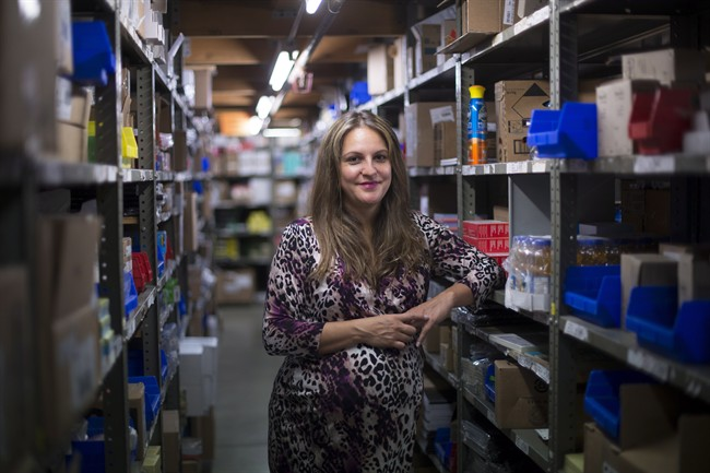 Michelle Reid of Mills Office Productivity poses for a photo in her company's warehouse in Vancouver, B.C., on Friday, June, 3, 2016. THE CANADIAN PRESS/Jonathan Hayward