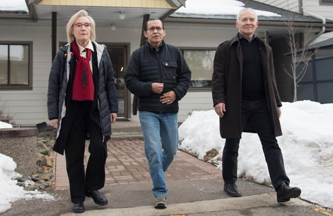 Wet'suwet'en hereditary leader Chief Woos, also known as Frank Alec, centre, Minister of Crown-Indigenous Relation, Carolyn Bennett, left, and B.C. Indigenous Relations Minister Scott Fraser arrive to address the media in Smithers, B.C., Sunday, March 1, 2020. THE CANADIAN PRESS/Jonathan Hayward