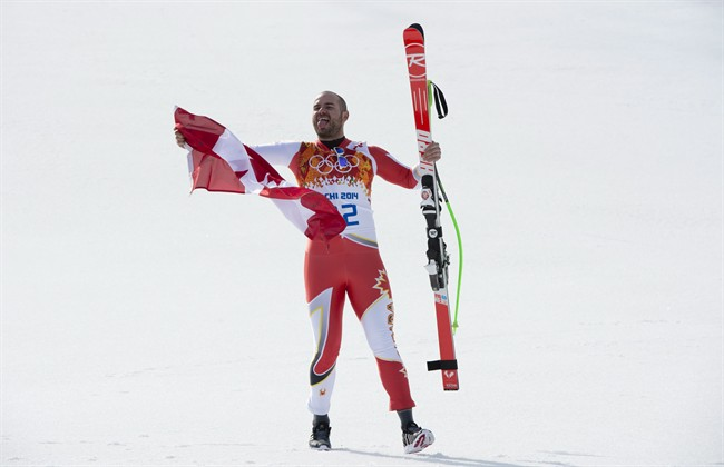 Canada's Jan Hudec celebrates his bronze medal win with a tie with Bode Miller of the United States following the Men's Super G at the Sochi Winter Olympics in Krasnaya Polyana, Russia, Sunday, Feb. 16, 2014. THE CANADIAN PRESS/Jonathan Hayward