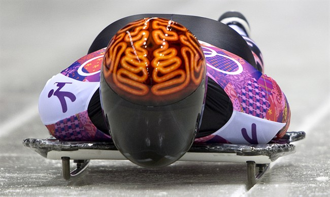 Canada's John Fairbairn slides at the Sochi Winter Olympics, Saturday, Feb. 15, 2014. THE CANADIAN PRESS/Jonathan Hayward