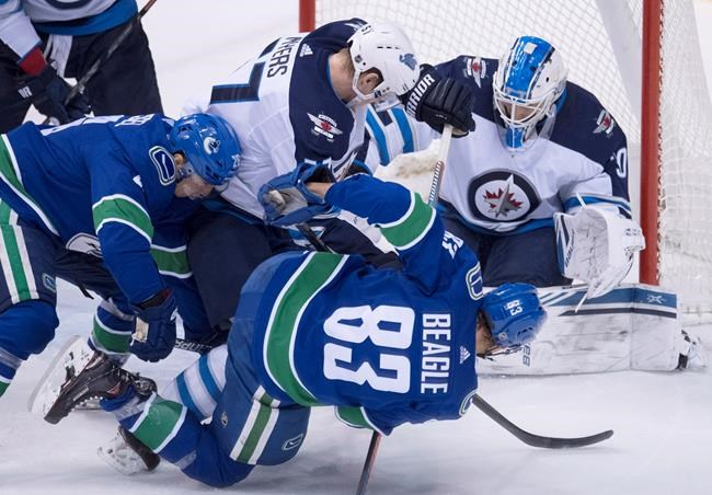 JONATHAN HAYWARD / THE CANADIAN PRESS FILES <p /> Jets goalie Laurent Brossoit earned the Jets' first shutout of the season in front of a hometown crowd in Vancouver.