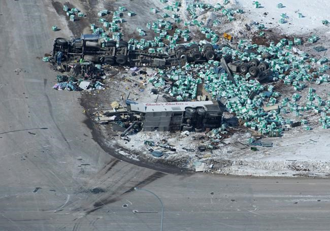 The wreckage of a fatal crash outside of Tisdale, Sask., is seen Saturday, April, 7, 2018. A bus carrying the Humboldt Broncos hockey team crashed into a truck en route to Nipawin for a game Friday night killing 14 and sending over a dozen more to the hospital.