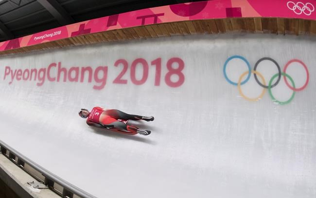 Candian luger Kim McRae, of Calgary, speeds down the track at the Olympic sliding centre prior to the start of the Pyeongchang 2018 Winter Olympic Games in South Korea, Thursday, Feb. 8, 2018. THE CANADIAN PRESS/Jonathan Hayward