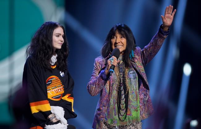Grimes and Buffy Sainte Marie are seen on stage at the Juno Awards in Vancouver, Sunday, March, 25, 2018. THE CANADIAN PRESS/Darryl Dyck