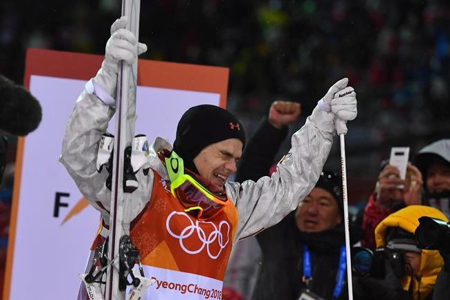 Canadian Mikael Kingsbury celebrates captured his first Olympic title in the men's moguls at the 2018 Winter Olympic Games at Phoenix Snow Park in Pyeongchang, South Korea, Monday, Feb. 12, 2018. THE CANADIAN PRESS/Jonathan Hayward