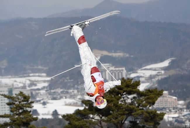 Canada's Mikael Kingsbury of Deux-Montagnes, Que. jumps during a men's freestyle moguls qualification run at the Phoenix Snow Park at the 2018 Winter Olympic Games in Pyeongchang, South Korea, Friday, Feb. 9, 2018. THE CANADIAN PRESS/Jonathan Hayward