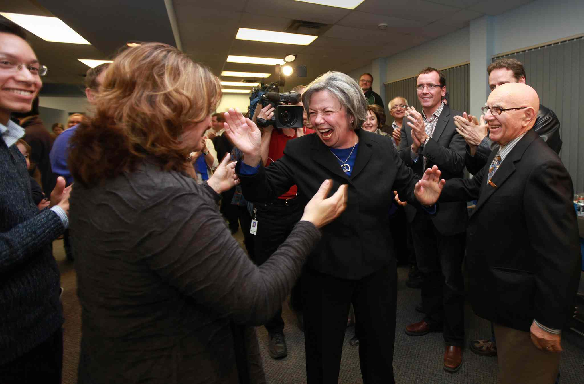 Joyce Bateman reacts to her supporters at her Corydon Ave headquarters on election night.