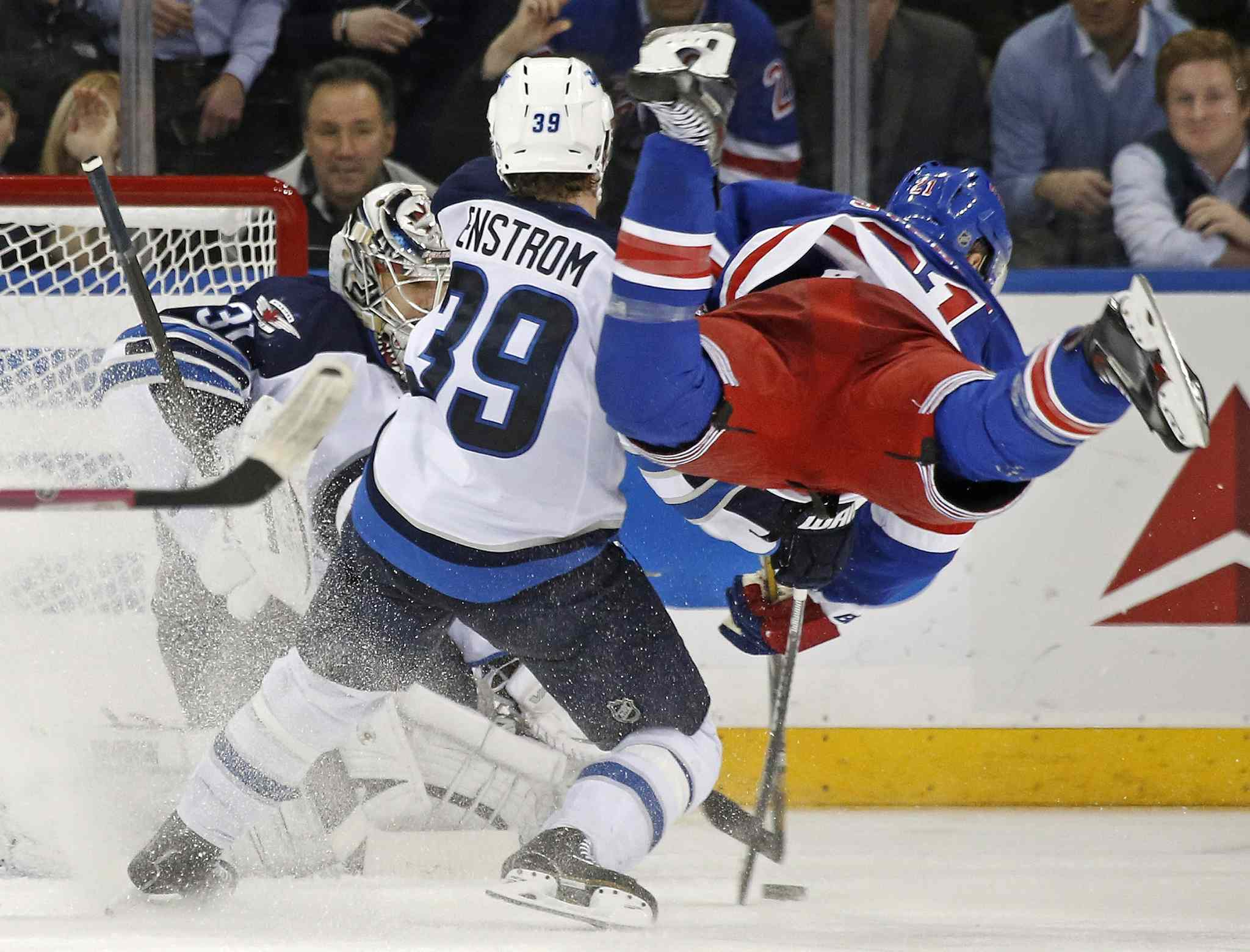Winnipeg Jets defenceman Tobias Enstrom sends New York Rangers centre Derek Stepan airborne Jets goalie Ondrej Pavelec makes a save in the third period of a NHL game at Madison Square Garden in New York, Monday. The Jets defeated the Rangers 5-2.
