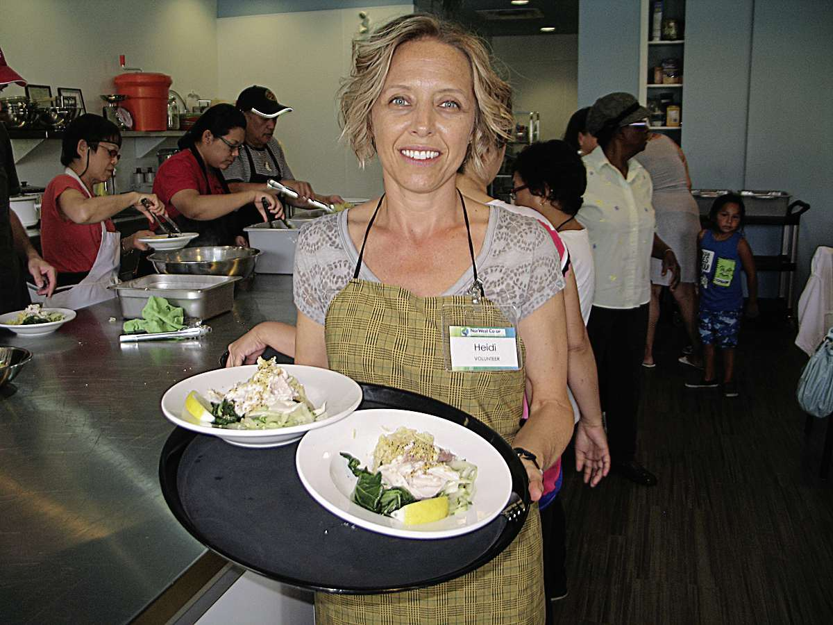 NorWest Co-op Community Food Centre volunteer Heidi DeFehr serves up northern Manitoba whitefish during the centre's triweekly community lunch.