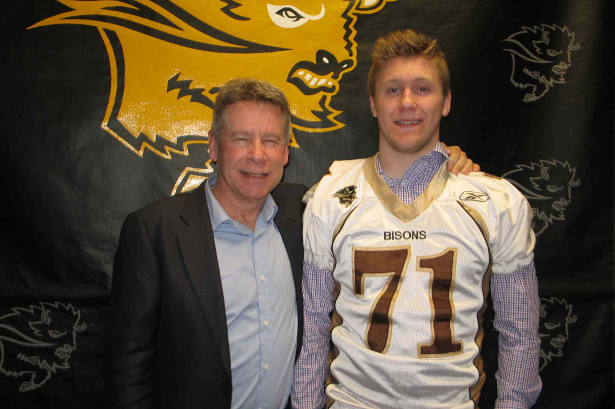 Manitoba Bisons head coach Brian Dobie (left) and Bisons recruit Riley Harrison.