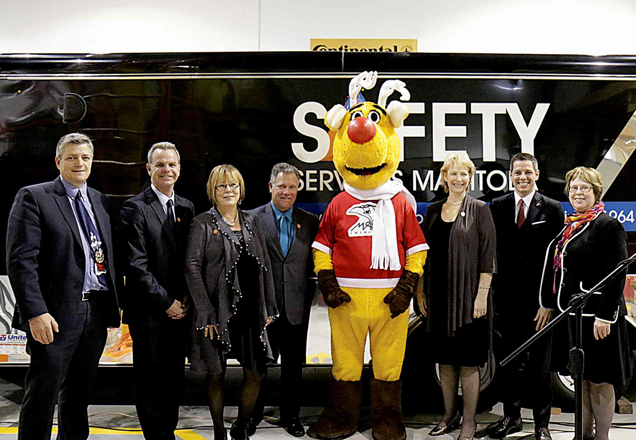 (From left) Scott Thomson, president and CEO of Manitoba Hydro, James Allum, MLA for Fort Garry-Riverview, Bev Mehmel, director, corporate social responsibility at Manitoba Liquor & Lotteries, Ward Keith, executive director, driver safety, DVA administration and registrar of motor vehicles at Manitoba Public Insurance, Operation Red Nose mascot Rudy, Guylaine Beaupré, executive director of Opération Nez Rouge National, Mayor Brian Bowman and Judy Murphy, president and CEO of Safety Services Manitoba.