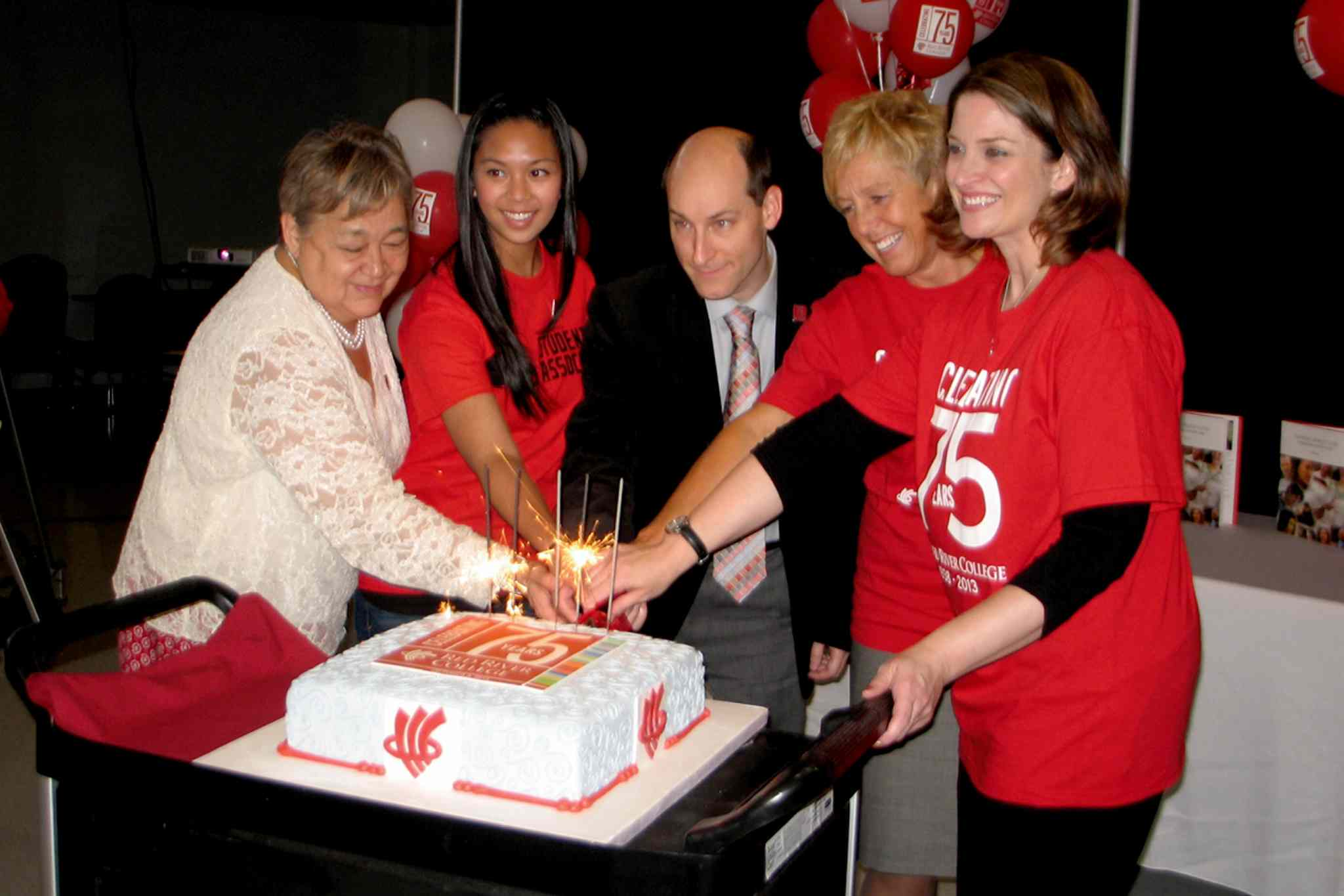 From left to right: RRC Elder-in-Residence Levinia Brown, RRCSA president Jocelle Cuvos, chair of RRC's board of governors Richard Lennon, RRC president and CEO Stephanie Forsyth and Minister for Advanced Education and Literacy Erin Selby cut RRC's 75th anniversary cake.