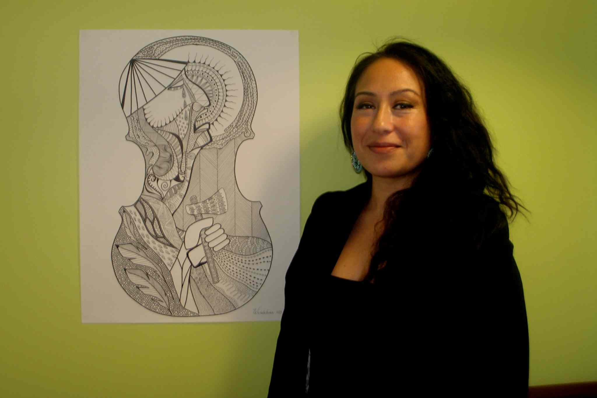 Winnipeg artist Wanda Luna beside Trauco, one of the pieces in her new exhibit Women of the Earth, on display at Neechi Commons until Nov. 30.