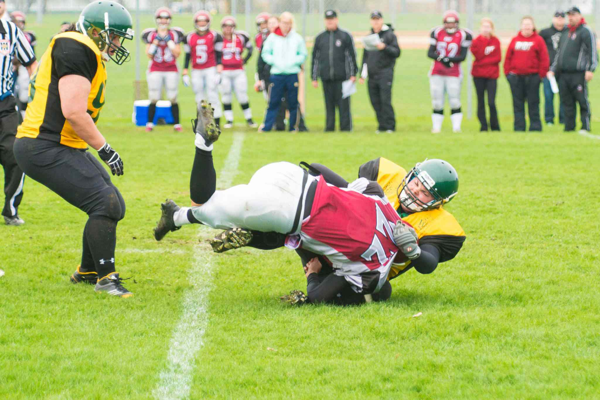 A North Winnipeg Nomads Wolfpack player tackles a member of the Regina Riot in Western Women's Canadian Football League action.