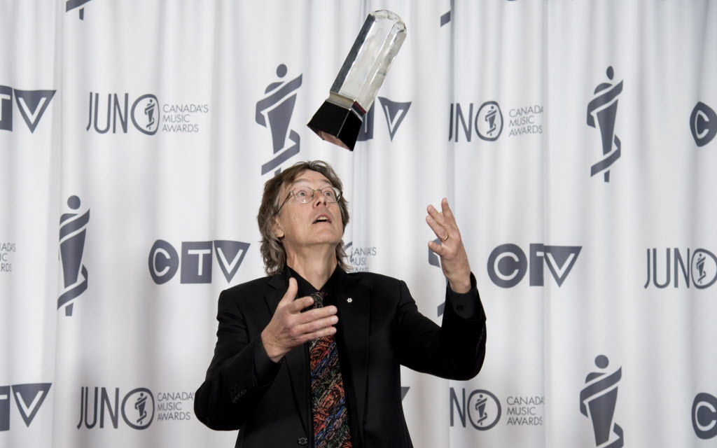 Allan Gordon Bell celebrates his Juno win for Classical Composition of the Year. (Jonathan Hayward / THE CANADIAN PRESS)