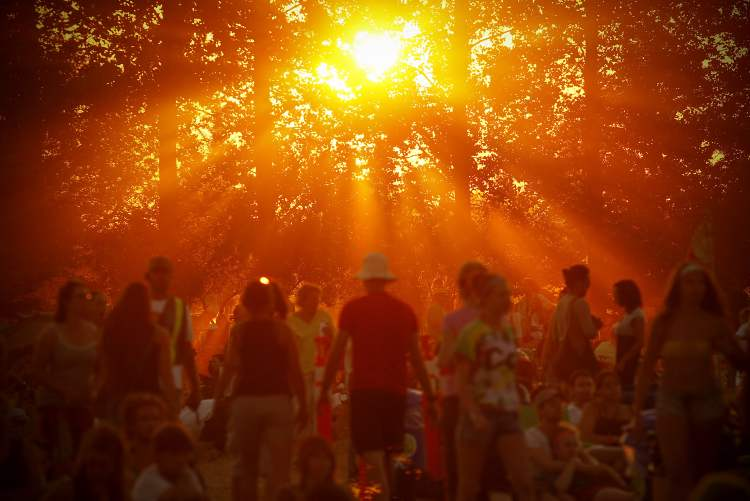 The placement of the sun beaming through the trees creates a warmth and tone the reader can't help but feel from this photo at the Winnipeg Folk Festival July 8, 2012.    (John Woods / Winnipeg Free Press)    (Winnipeg Free Press)