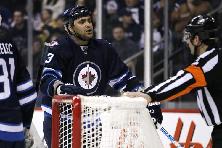 Dustin Byfuglien lets the referee know what he's thinking during the first period. (JOHN WOODS / WINNIPEG FREE PRESS)
